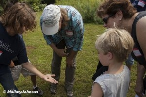The kids admire a slug with Debbie Beer.  Photo @ Mallary Johnson.  Click to enlarge.